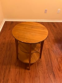 Round brown wooden side table (2 available) Sugar Land, 77478