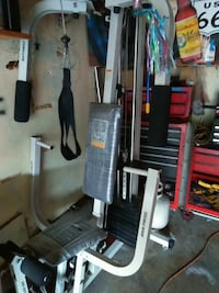 gray and black Weider butterfly machine