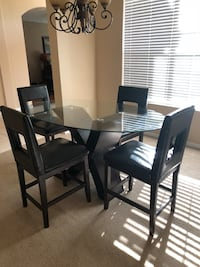 Black Oval Glass Dining Room Table with chairs Kissimmee, 34746