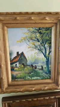 brown wooden framed painting of house Montréal, H3R 2E6