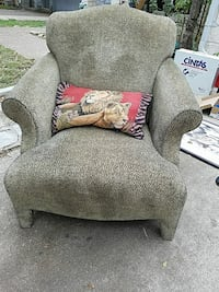 gray padded armchair