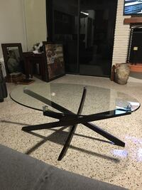 Black metal framed glass top table Redington Beach, 33708