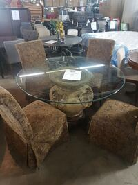 round clear glass top table with four chairs Mississauga, L4X 1R1