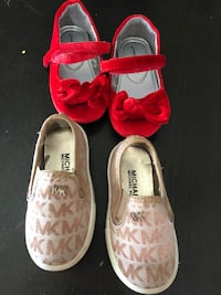 Pair of pink-and-white low top sneaks red shoes size 6 mk size 2 Tampa, 33625