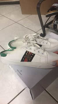 pair of white-and-green low top sneakers Calgary, T2B 3G1