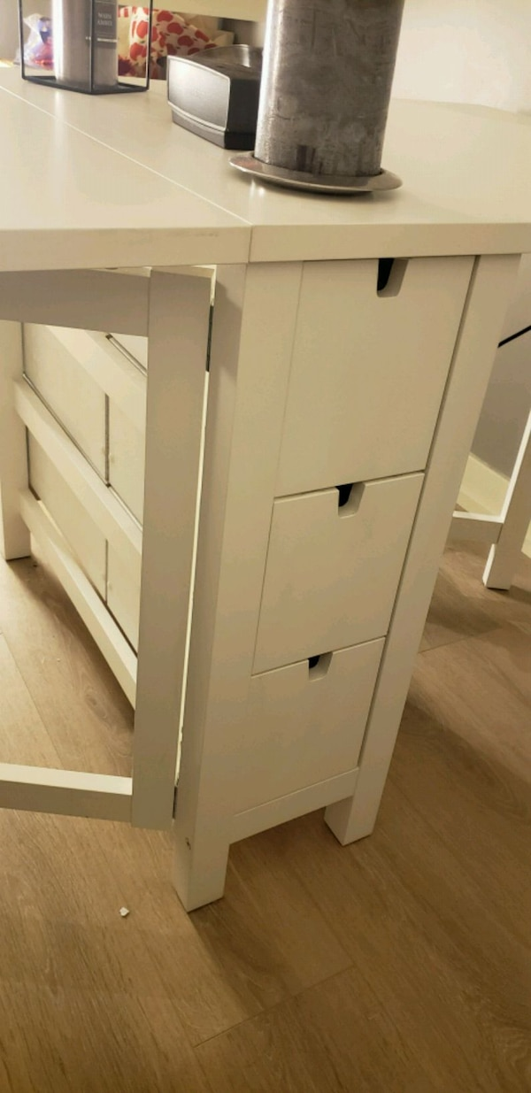 Space saving dinner table w/ storage and 4 chairs 819437d2-de3e-430e-ac9a-34c1094a1411