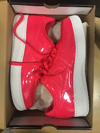Pair of red nike air force 1 low shoes size 10