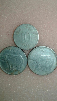 three silver round coins