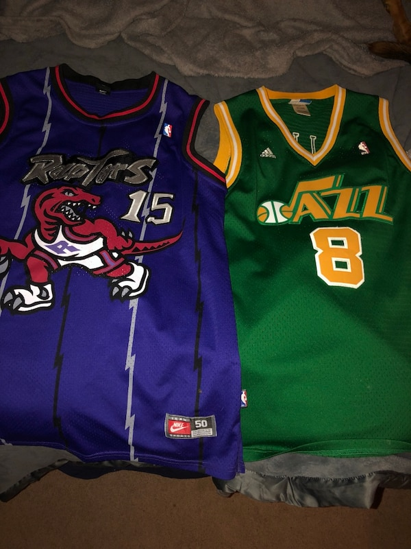 detailed look 3fada fbab0 two blue and green Toronto Raptors and Utah Jazz jersey shirts