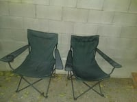 Two folding lawn chairs with cup holders