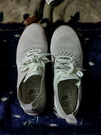 pair of gray-and-white Nike running shoes Garland, 75043