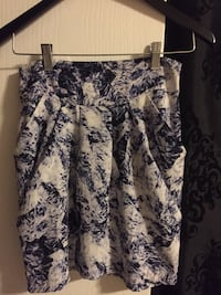 white and blue floral pleated mini skirt