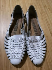 pair of white-and-black Adidas sneakers Vancouver, V5R 4N1