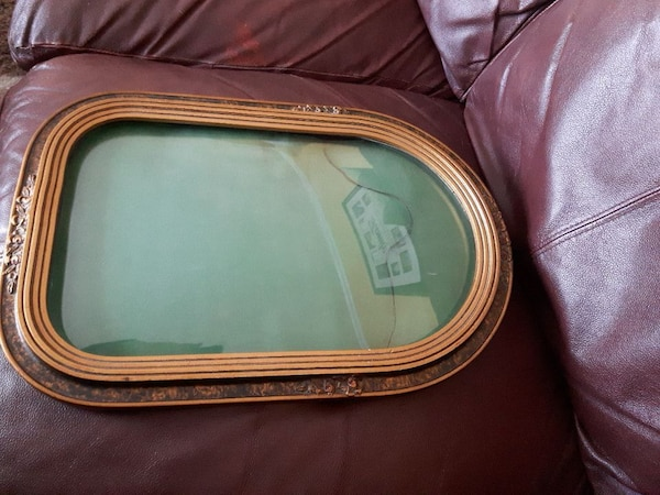 Antique bubble glass frame.