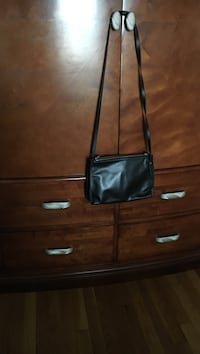 Women's black leather sling bag