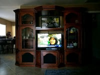 brown wooden TV hutch with flat screen television Perris, 92570