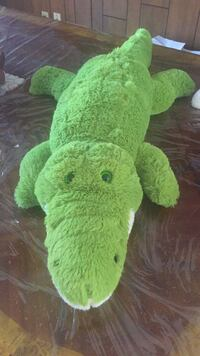 green and white animal plush toy