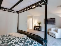 Black king sized canopy bed Arlington, 22207