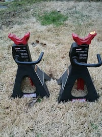 two black-and-red Pro Lift stand jacks