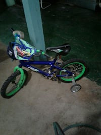 blue and green bicycle with training wheels