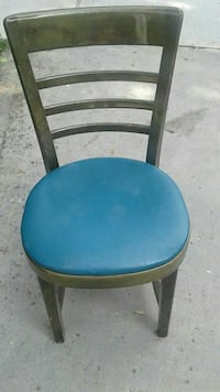 round blue and black wooden chair