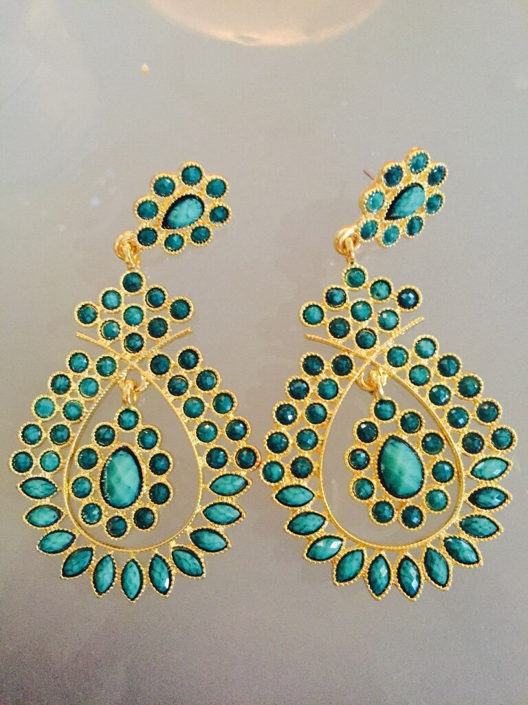 Gold colored and blue colored earrings