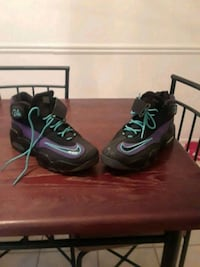 pair of black-and-green Nike basketball shoes