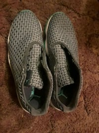 pair of gray-and-black Nike running shoes Long Beach, 90813