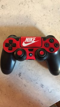 Red and black sony ps4 controller Roosevelt, 11575