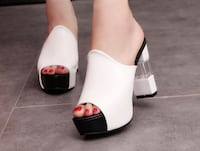 Pair of white leather open-toe heeled sandals North Vancouver, V7R 2L3