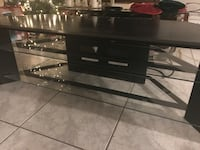 black wooden TV stand, corner table w/ glass shelves and serge protector