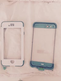two white and blue iPhone cases