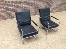 Two stainless steel frame with black leather pad armchairs