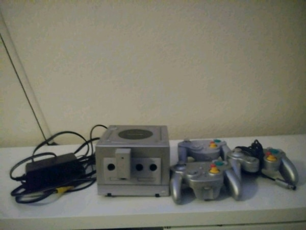 white Nintendo Wii console with controllers