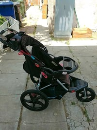 baby's black and red jogging stroller Los Angeles, 90043