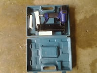 blue and black power tool in case Rowlett, 75088