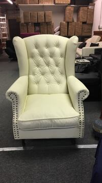 tufted yellow leather wing chair London, N6L 1C1