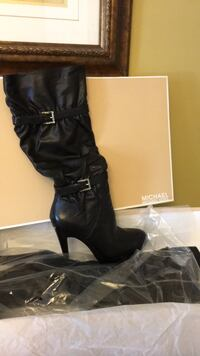 pair of black leather knee-high boots Bolton, L7E 1C8