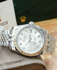 round silver-colored chronograph watch with link bracelet Brossard, J4W 2T5
