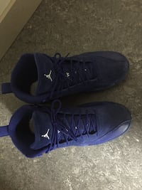 Pair of blue air jordan basketball shoes Surrey, V3T 4M7