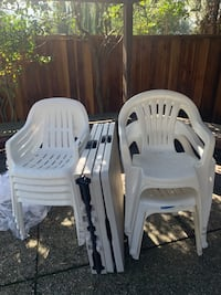 White plastic stackable chair