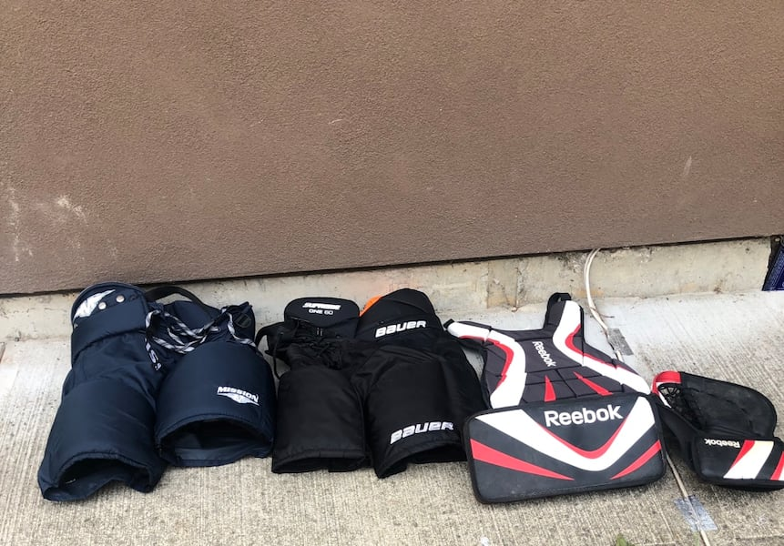 Two hockey pants size small. And some Reebok goalie supplies 0b6a1a23-8640-4aae-b5a4-e5fc839ce44d