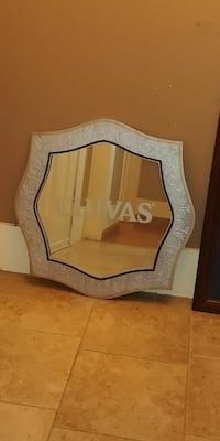 scalloped-edge white and brown wooden wall mirror