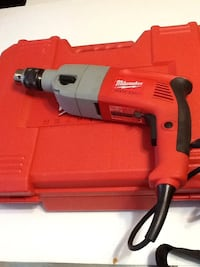 red and black Milwaukee corded hand drill with case Montréal, H8P 2X1