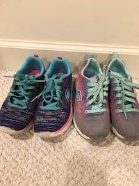 two pairs of black and blue running shoes 50 km