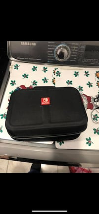 Nintendo switch with 2 games, travel case, pro controller. New York, 11367