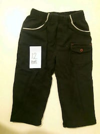 black and gray pants with text overlay 790 km