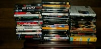 Variety of 54 dvds, some unopened  San Diego