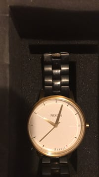 Nixon gold and black watch with box Orlando, 32828