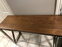 New console table with metal metal frame see pictures size LxWxH 47x16x31 asking $140 contact Richard  [PHONE NUMBER HIDDEN]  Toronto, M9V